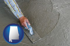 alabama map icon and smoothing a concrete surface with a trowel