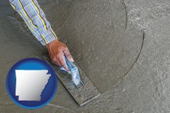 arkansas map icon and smoothing a concrete surface with a trowel