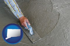 connecticut map icon and smoothing a concrete surface with a trowel