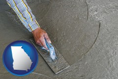 georgia map icon and smoothing a concrete surface with a trowel