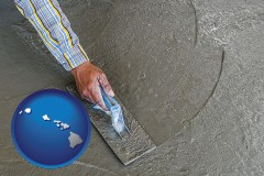 hawaii map icon and smoothing a concrete surface with a trowel