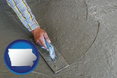 iowa map icon and smoothing a concrete surface with a trowel