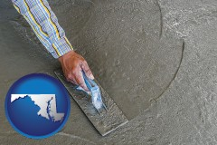 maryland map icon and smoothing a concrete surface with a trowel