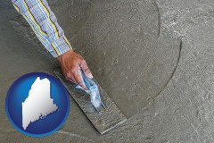 maine map icon and smoothing a concrete surface with a trowel