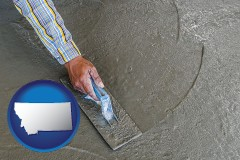 montana map icon and smoothing a concrete surface with a trowel