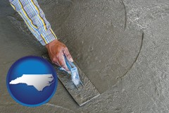 north-carolina map icon and smoothing a concrete surface with a trowel