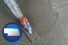 nebraska map icon and smoothing a concrete surface with a trowel