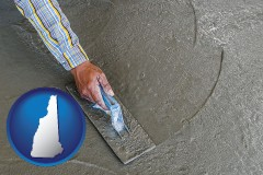 new-hampshire map icon and smoothing a concrete surface with a trowel