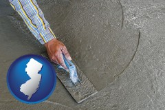 new-jersey map icon and smoothing a concrete surface with a trowel