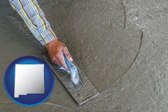 new-mexico map icon and smoothing a concrete surface with a trowel