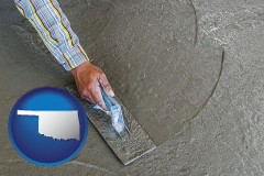 oklahoma map icon and smoothing a concrete surface with a trowel