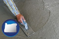 oregon map icon and smoothing a concrete surface with a trowel