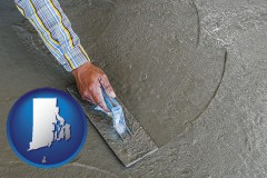 rhode-island map icon and smoothing a concrete surface with a trowel