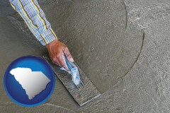 south-carolina map icon and smoothing a concrete surface with a trowel