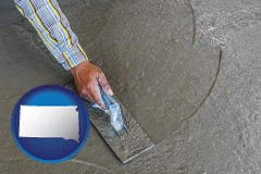 south-dakota map icon and smoothing a concrete surface with a trowel