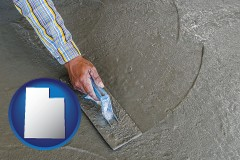 utah map icon and smoothing a concrete surface with a trowel
