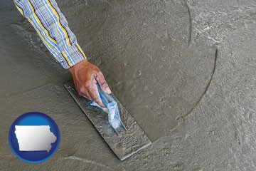 smoothing a concrete surface with a trowel - with Iowa icon