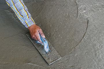 smoothing a concrete surface with a trowel